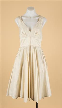 Sale 9260H - Lot 323 - An Aurelio Costarella off-white sleeveless dress with zip to back, size 4.