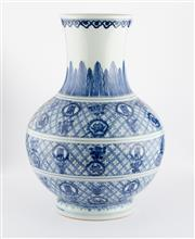 Sale 8536 - Lot 51 - A Ching style blue and white vase painted with geometric pattern and peach and shou calligraphy, H 30cm