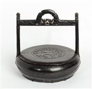 Sale 8844 - Lot 74 - A Chinese black painted timber lidded basket with fish carved decoration. Height 35cm. Diameter 37cm.