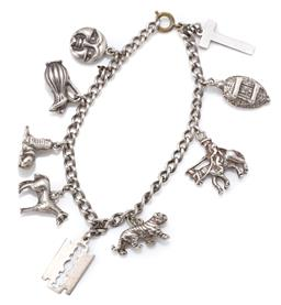 Sale 9124 - Lot 323 - A SILVER CHARM BRACELET; curb link chain attached with 9 charms to brass bolt ring clasp, length 18cm, wt. 29.04g.