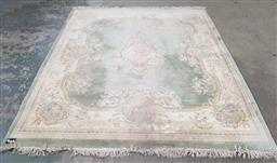 Sale 9255 - Lot 1344 - Handknotted cream & green tone carpet (300 x 2.5cm) some condition issues