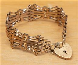 Sale 9165H - Lot 85 - A 9ct gold gate bracelet with heart padlock clasp, maker AJ Co, Weight 21.5g