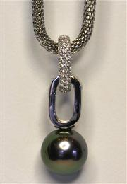 Sale 8036A - Lot 349 - A TAHITIAN PEARL PENDANT; 13.2mm round fine quality cultured pearl to a silver surmount set with zirconias. Metal chain.