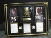 Sale 8125 - Lot 100 - The Godfather by Mario Puzo & Fracis Ford Coppola - framed collage incl signed screenplay & Brando bust. Impressive!