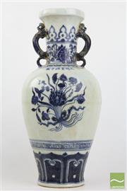 Sale 8494 - Lot 50 - Chinese blue and white double handled vase, Xuande mark, body decorated with three lotus floral roundels