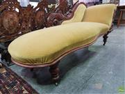 Sale 8617 - Lot 1005 - Late Victorian Carved Walnut Chaise Longue, the pierced back upholstered in gold velvet & raised on turned legs