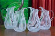 Sale 8677B - Lot 646 - Four candystripe glass water jugs H x 28cm