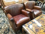 Sale 8882 - Lot 1053 - Pair of French Style Leather Club Chairs, with slightly rolled & studded arms, having loose leather cushions.