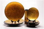 Sale 9057 - Lot 67 - An assortment of large circular platters and plates in gold lacquer finish with vase and tray