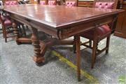 Sale 8267 - Lot 1010 - Early 20th Century French Carved Walnut Extension Dining Table, with three leaves & fold-down supports, raised on turned legs joined...