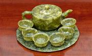 Sale 8815A - Lot 100 - An eight piece spinach jade tea service, to include pot, plate and six glasses, H of pot 6cm