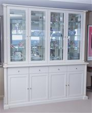 Sale 8593A - Lot 32 - A pair of ivory laminate and glass display cabinets of generous proportions, with four glazed doors over four drawers, over four doo...