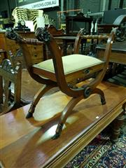 Sale 8653 - Lot 1006 - Classical Style Mahogany Curule Chair, the X frame with rams head terminals and hoof feet