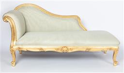Sale 9140W - Lot 39 - A custom built chaise longue in Louis XV styled European hand carved wood with gilded leaf finish upholstered with Colefax and Fowle...