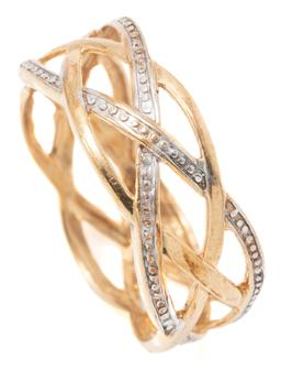 Sale 9149 - Lot 549 - A 9CT GOLD RING TWO TONE; 8mm wide yellow & white gold open plaited design, size O, wt. 2.41g.