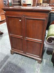 Sale 8792 - Lot 1019 - An Essentially Georgian Oak Cabinet, with twin panelled doors and iron carry handles to the sides, raised on bracket feet (faults),...