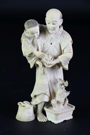 Sale 8897 - Lot 5 - Japanese Meiji Ivory Carving Okimono of an Elder and Child (H 14cm), signed to base