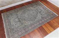 Sale 9080H - Lot 93 - A Persian rug with floral medallion design in muted tones, 225cm x 145cm
