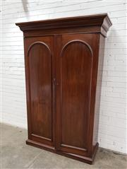 Sale 9085 - Lot 1009 - 19th Century Cedar Wardrobe, with two arched panel doors, enclosing shelving, slides & a long drawer - key in office (h:211 x w:123...