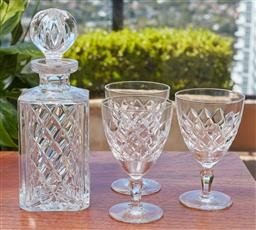 Sale 9099 - Lot 291 - An Orrefors drink suite with decanter and three goblets, decanter Height 24.5cm