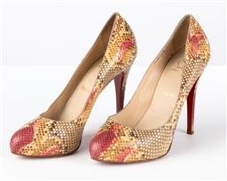 Sale 9250F - Lot 48 - A pair of Christian Louboutin red bottom heels, size 39 1/2.