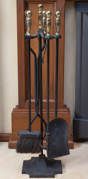 Sale 8677B - Lot 655 - A set of cast iron firetools on a stand