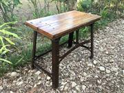 Sale 8706A - Lot 65 - A garden potting table, metal legs and frame and timber top, general wear, some chipping on timber, surface rust, H 79 x W 103cm