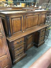 Sale 8882 - Lot 1018 - Victorian Oak Bureau, the panelled fall front enclosing shelves & drawers, above an alcove cupboard & six drawers (key in office)