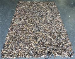 Sale 9188 - Lot 1627 - Shredded leather floor covering (265 x 190cm0