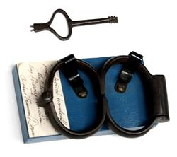 Sale 7919A - Lot 1805 - Handcuffs with Key Presented to E. A. Dearn by Harry Houdini