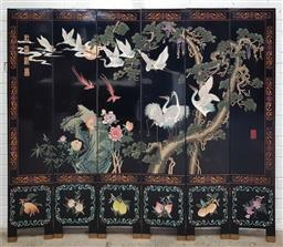 Sale 9126 - Lot 1194 - Chinese Six Panel Carved Black Lacquer Screen, with migrating cranes resting on a conifer tree, above smaller panels with seasonal f...