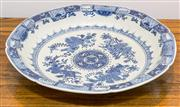 Sale 8308A - Lot 189 - A large Chinese blue and white charger, floral motif, K'ang Hsi marks to base, Dia.41cm