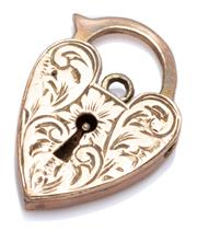 Sale 9029 - Lot 331 - A 9CT GOLD PADLOCK; engraved heart shape padlock, size 28 x 19mm, wt. 6.87g.