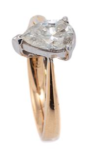 Sale 9083 - Lot 408 - A TWO TONE 18CT GOLD STONE SET RING; set in white gold collet with an 8 x 5mm pear shape synthetic moissanite on a rose gold shank,...