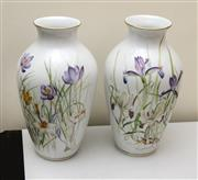 Sale 8205 - Lot 52 - A pair of hand painted signed porcelain Limoges vases with irises and gilt highlights, by Nikhe Goulandis