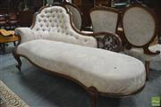 Sale 8291 - Lot 1044 - A Victorian Carved and Pierced Walnut Chaise Lounge, in butted cream floral fabric, with addition roll of fabric