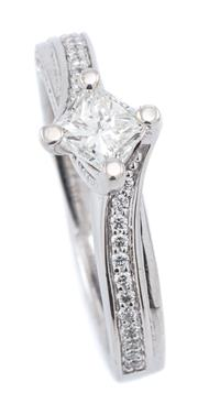 Sale 9083 - Lot 500 - AN 18CT WHITE GOLD DIAMOND RING; centring a princess cut diamond of approx. 0.45ct G/VS2, between slightly bypass shoulders and side...