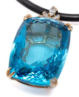 Sale 9149 - Lot 505 - A LARGE TOPAZ AND DIAMOND PENDANT; split claw set with an approx. 77ct, (21.3 x 28.3mm) fancy cushion cut blue topaz surmounted by a...