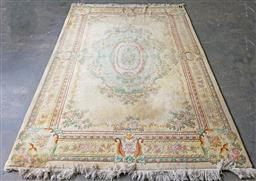 Sale 9255 - Lot 1286 - Yellow tone oriental style carpet ( 310 x 200cm) some stains & mould underneath