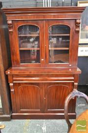 Sale 8282 - Lot 1079 - Victorian Mahogany Bookcase, with short top with two glass panel doors, long drawer above to panel doors. (key in office)