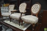 Sale 8291 - Lot 1045 - A Victorian Carved Walnut Gentlemans Chair and Two Similar Ladys Chairs, upholstered in matching cream buttoned fabric