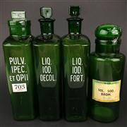 Sale 8567 - Lot 703 - Four Antique Green Glass Labelled Pharmacy Bottles with stoppers