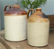 Sale 8745A - Lot 86 - A non matching pair of earthenware demijohns, both with stoppers, tallest 38cm