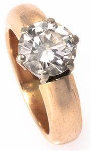 Sale 8937 - Lot 418 - AN 18CT GOLD SOLITAIRE DIAMOND RING; claw set with a round brilliant cut diamond, with GSL diamond report no. AA 28377 stating  diam...