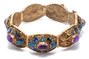 Sale 9046 - Lot 387 - A VINTAGE CHINESE ENAMELLED SILVER GILT AMETHYST  BRACELET; 7 filigree links each centring an oval cabochon amethyst to surrounds of...