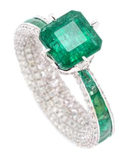 Sale 9160 - Lot 389 - AN 18CT WHITE GOLD EMERALD AND DIAMOND RING; claw set with a square emerald cut emerald of approx. 2.96ct to claws, gallery and full...