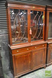 Sale 8359 - Lot 1093 - An Edwardian Inlaid Mahogany Bookcase in the Georgian Manner with 2 astragal doors, 2 drawers and 2 panel doors (Key in Office)