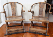 Sale 8677B - Lot 665 - A pair of Chinese horseshoe back campaign chairs, H x 106cm, W x 82cm