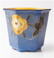 Sale 9048A - Lot 37 - A Bretby hexagonal hand painted jardiniere with a yellow flower on a blue ground, daisy mark to base, Height 19cm