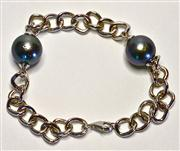 Sale 8036A - Lot 310 - A TAHITIAN PEARL BRACELET; featuring 2 x 12.2mm round cultured pearls with high lustre on a curb link silver bracelet.